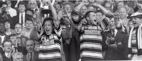 Hull FC scrum half Greg Mackey lifting the 1991 Premiership Trophy